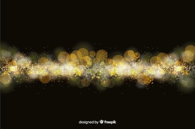 Bokeh sfondo con particelle d'oro
