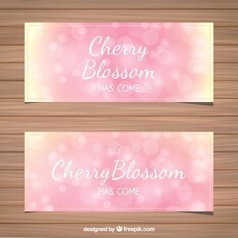 Bokeh striscioni fiore di ciliegio in toni rosa