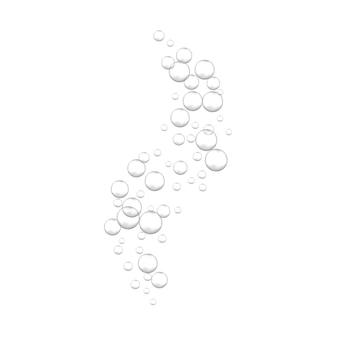 Bolle effervescenti dell'acqua effervescente su bianco