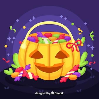 Borsa di zucca con caramelle per la notte di halloween