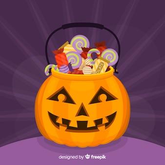 Borsa di zucca piena di caramelle per halloween