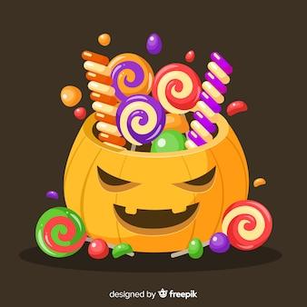 Borsa disegnata a mano della zucca di halloween con i dolci