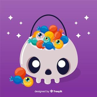 Borsa disegnata a mano sveglia del cranio di halloween