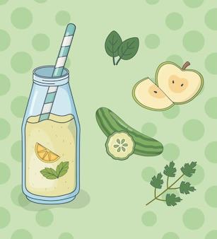 Bottiglia di succo di mela e cetriolo con paglia