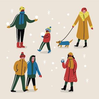 Branco di persone che indossano abiti invernali