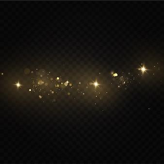 Brilla su uno sfondo trasparente. scintillanti particelle di polvere magica. scintille di polvere e stelle dorate brillano di luce speciale.