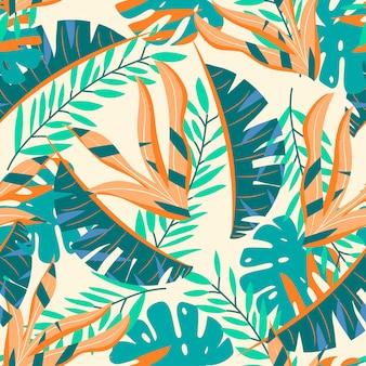 Brillante modello senza saldatura con foglie tropicali verde e arancione