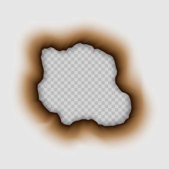 Buco bruciato nella carta. brucia isolato
