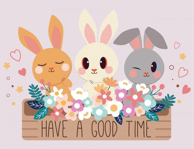 Buon divertimento, auguri con i personaggi di un simpatico coniglio seduto di fianco al grande vaso con un fiore