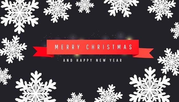 Buon natale e felice anno nuovo sfondo con carta tagliata fiocchi di neve bianchi, nastri rossi su oscurità