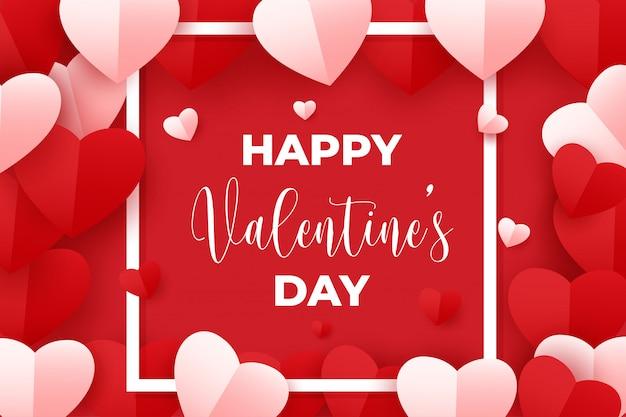 Buon san valentino con cuori di carta rossa e rosa su rosso