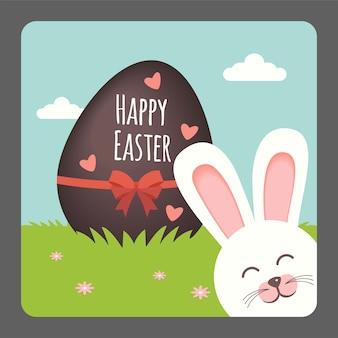 Buona pasqua con coniglietto sorridente e uovo di cioccolato