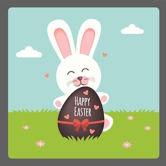 Buona pasqua con coniglio e uovo di cioccolato