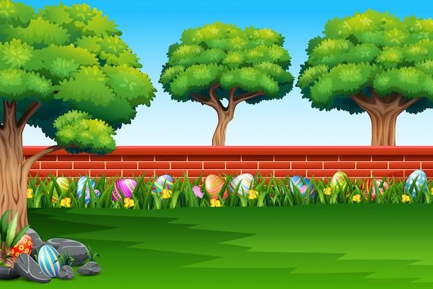 Buona pasqua sulla natura con uno sfondo di recinzione di mattoni