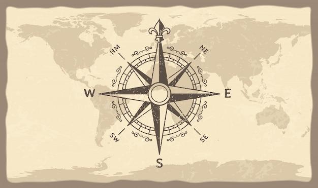 Bussola antica sulla mappa del mondo