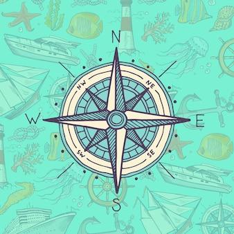 Bussola colorata e abbozzata sugli elementi del mare
