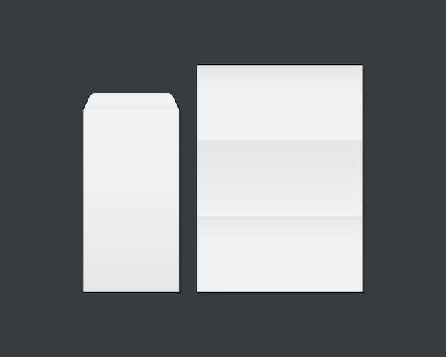 Busta e carta bianche in bianco. modello aperto di busta e carta isolato su sfondo nero. modello per identità aziendale e di branding.