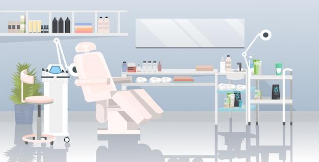 Cabina per estetista con macchina per epilazione laser e poltrona