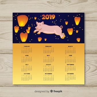 Calendario cinese del nuovo anno con maiale