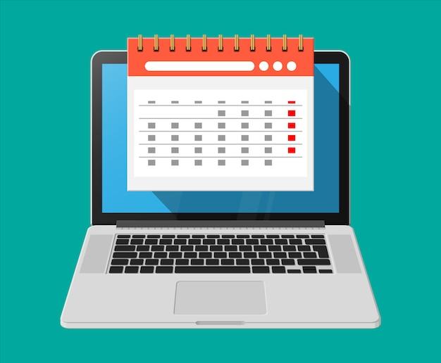 Calendario murale a spirale di carta in computer portatile