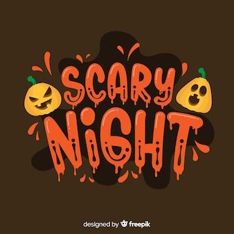 Calligrafia di notte spaventosa con zucche