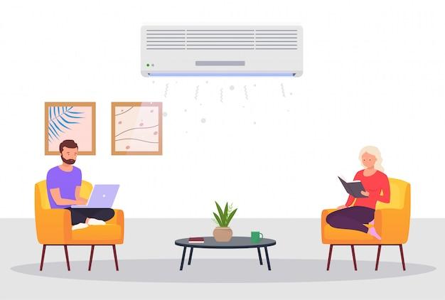 Camera con aria condizionata e persone. l'uomo e una donna lavorano al computer portatile, si rilassano a casa nella stanza con il raffreddamento. concetto di controllo del clima in ambienti chiusi.