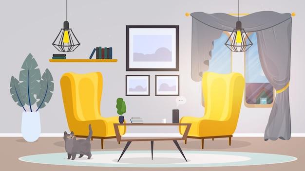 Camera in stile loft. poltrone gialle, un tavolo con libri, gatto, quadri, moquette, pianta d'appartamento. interni in stile loft alla moda