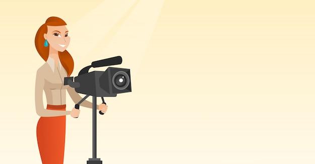 Cameraman con una cinepresa su treppiede.
