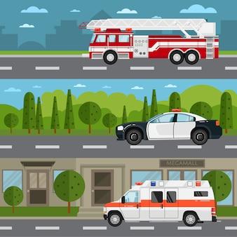 Camion dei pompieri, polizia e auto ambulanza sulla strada principale