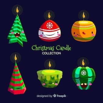 Candela natalizia con collezione di volti