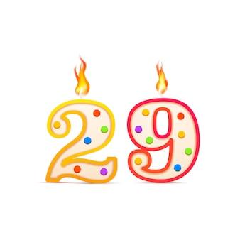 Candeliere di compleanno a ventinove anni, 29 numeri a forma di numero con fuoco su bianco