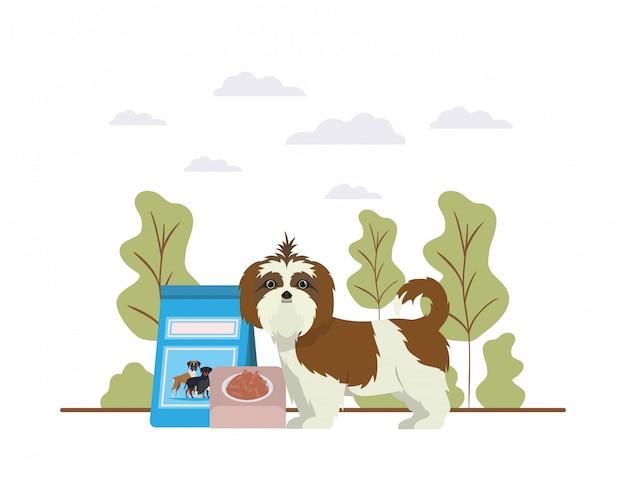 Cane con ciotola e cibo per animali sul paesaggio