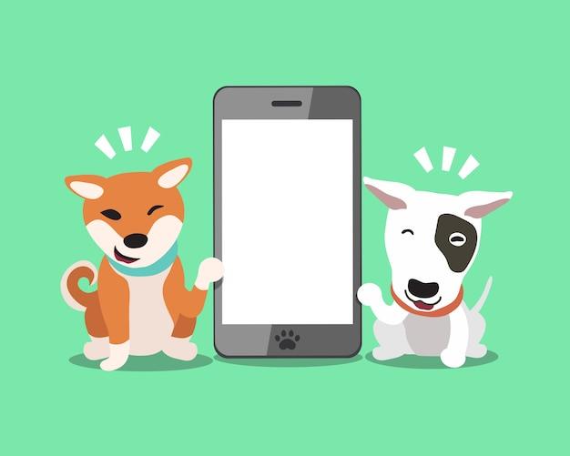 Cane di bull terrier e cane di inu di shiba con lo smartphone