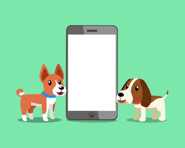 Cane e segugio di basenji con lo smartphone