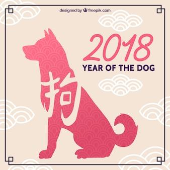 Capodanno cinese design con cane rosa