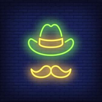 Cappello e baffi del leprechaun per il giorno di st patrick sul fondo del mattone.