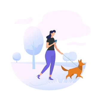 Carattere della giovane donna che cammina con il cane in parco