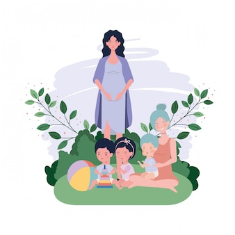 Carine madri in gravidanza sedevano sollevando bambini nel campo