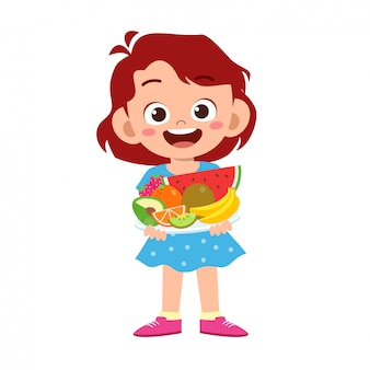 Carino bambino felice con frutta
