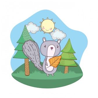 Carino piccolo scoiattolo con foglia nel campo