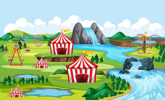 Carnevale e parco divertimenti con scena di paesaggio sul lato del fiume