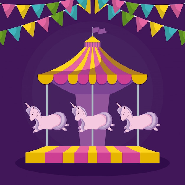 Carosello con unicorni e ghirlande appese