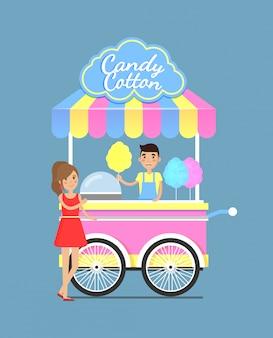 Carrello luminoso da strada con gustoso dolce zucchero filato in cotone
