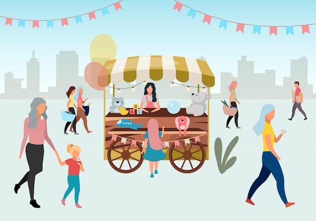 Carretto di legno del mercato di strada con l'illustrazione dei giocattoli. negozio di circo retrò stallo su ruote. carrello commerciale con giocattoli artigianali. la gente cammina festival estivo, personaggi dei cartoni animati di negozi all'aperto di carnevale