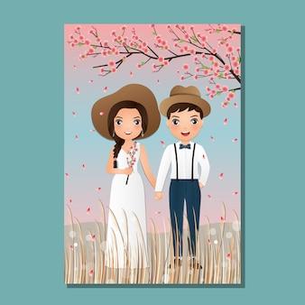 Carta dell'invito di nozze il fumetto sveglio delle coppie dello sposo e della sposa con la piena fioritura del fiore di ciliegia. paesaggio bello nel fondo di tempo di primavera