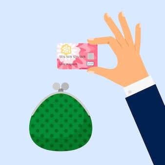 Carta di credito della holding della mano dell'uomo d'affari