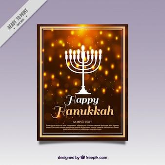 Carta di hanukkah con sfondo sfocato e cornice dorata