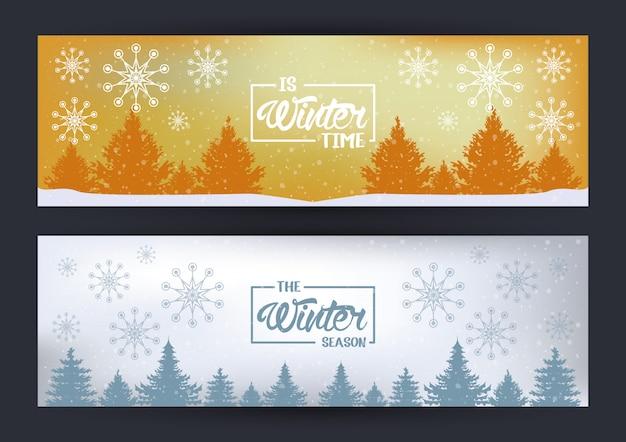 Carta di inverno con fiocchi di neve e scena della foresta