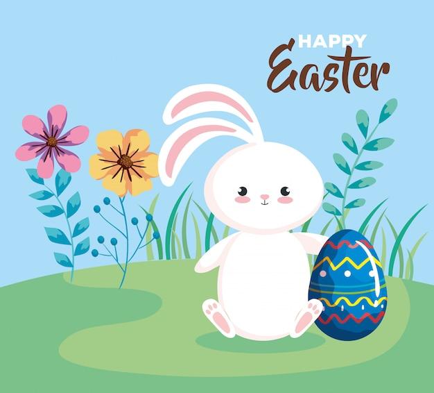 Carta di pasqua felice con coniglio e l'uovo nel paesaggio