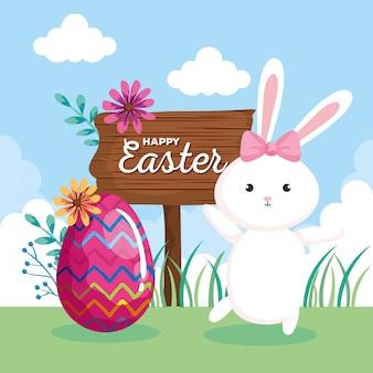 Carta di pasqua felice con coniglio e l'uovo
